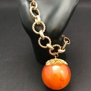 Vintage gold tone link bracelet with orange ball